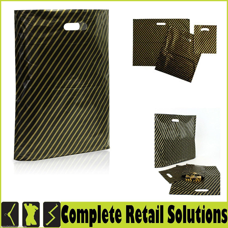 100xNEW PLASTIC CARRIER BAGS BLACK& GOLD LEOPARD TIGER UNION JACK DIE CUT HANDLE (BLACK& GOLD) Complete Retail Source ltd
