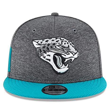 newest fc412 b0c04 Image Unavailable. Image not available for. Color  New Era Jacksonville  Jaguars 2018 Sideline Onfield NFL Graphite Charcoal Teal 9Fifty Snapback ...