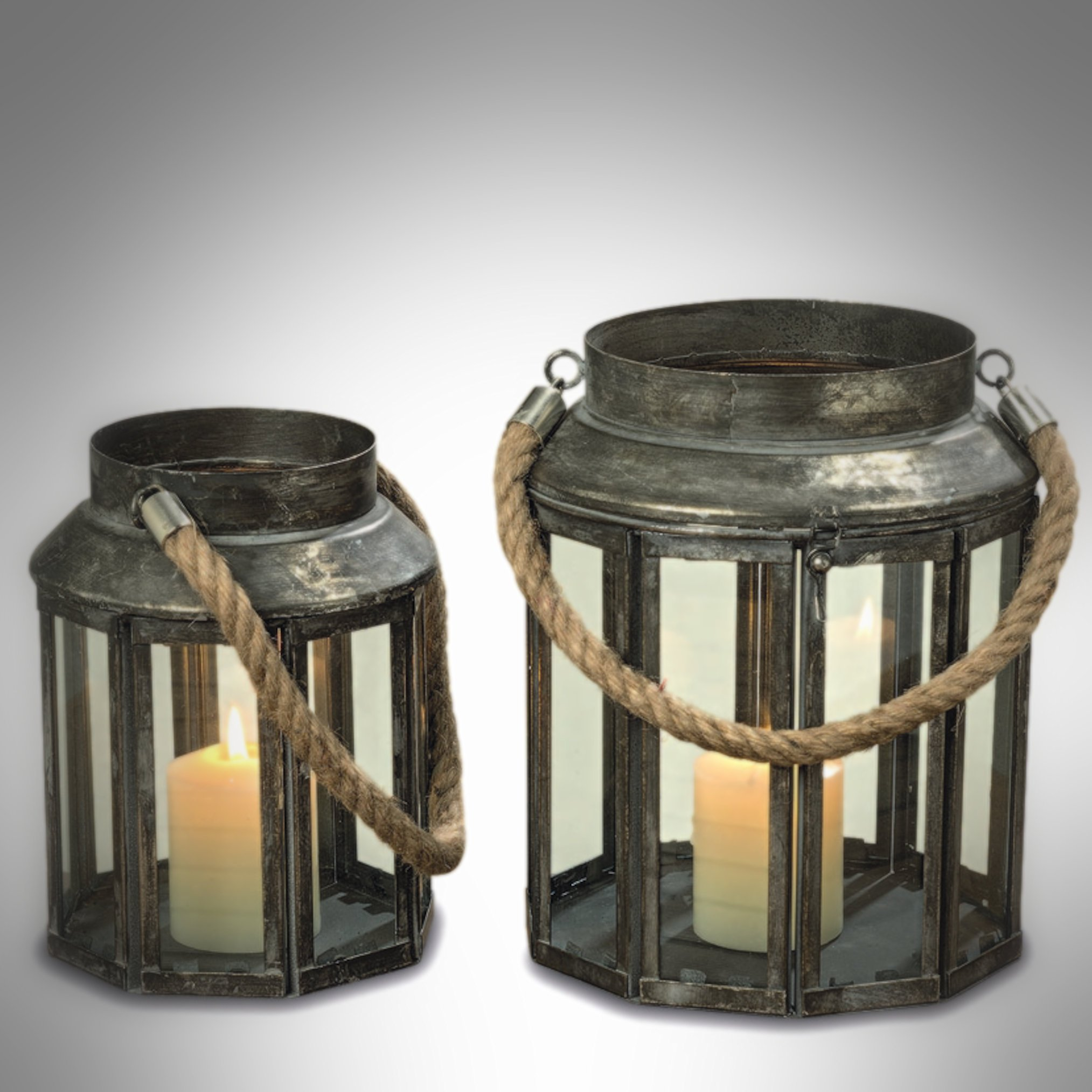 The Mariner's Candle Lanterns, Set of 2, Glass Panel, Aged Galvanized Metal, Nautical Rope Handles, Top Opening, Swing Latch, 10 Sided - 9 3/4 and 8 Sided - 6 1/4 Inches Tall, By Whole House Worlds by Whole House Worlds