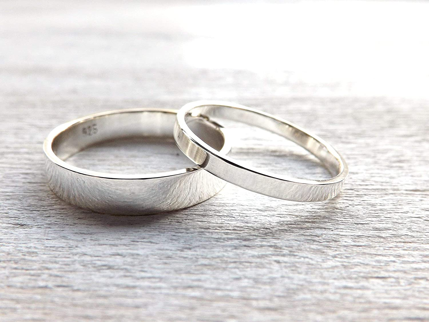 It is just a picture of Amazon.com: flat silver ring set slim and simple, matching wedding