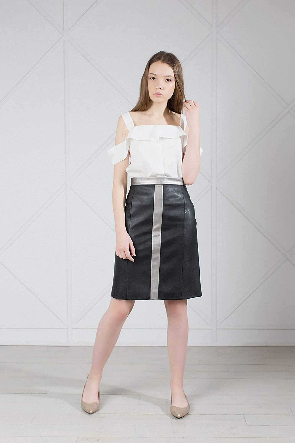 0216eac810 This black pencil faux leather midi skirt decorated with the metallic belt  and stripe in front. Premium quality fabrics, with a focus on great  tailoring and ...