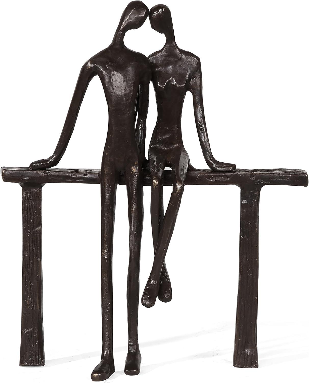 ejemplo de escultura de pareja reclinada