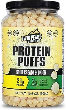 Twin Peaks es bajo en calorías, Protein Puffs es apto para alérgicos, Crema de Cebolla Agria (300g, 21g de proteína, 2g de carbohidratos, 130 ...