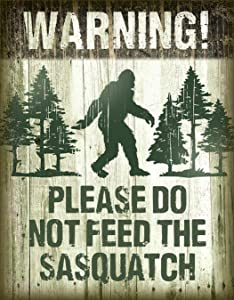 "Desperate Enterprises Warning! Please Do Not Feed The Sasquatch Tin Sign, 12.5"" W x 16"" H"