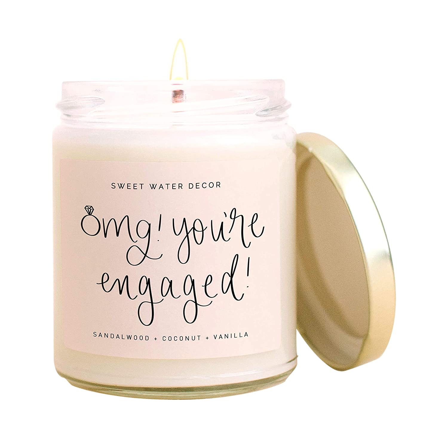 Sweet Water Decor, OMG, You're Engaged! | Coconut, Mahogany, Vanilla, Sandalwood, Musk Scented Soy Wax Candle for Home | Engagement Gift | 9oz Clear Glass Jar, 40 Hour Burn Time, Made in the USA