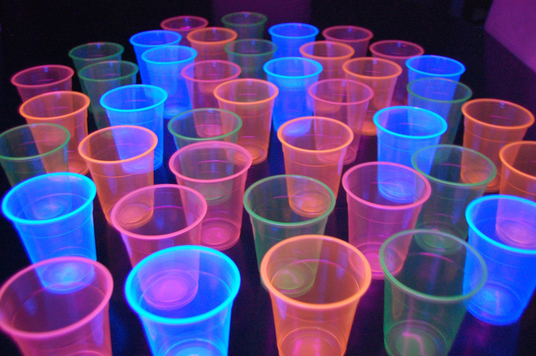 12oz Neon Assorted Blacklight Reactive Soft Plastic Cups with Free Blacklight Balloons (40) by DirectGlow LLC