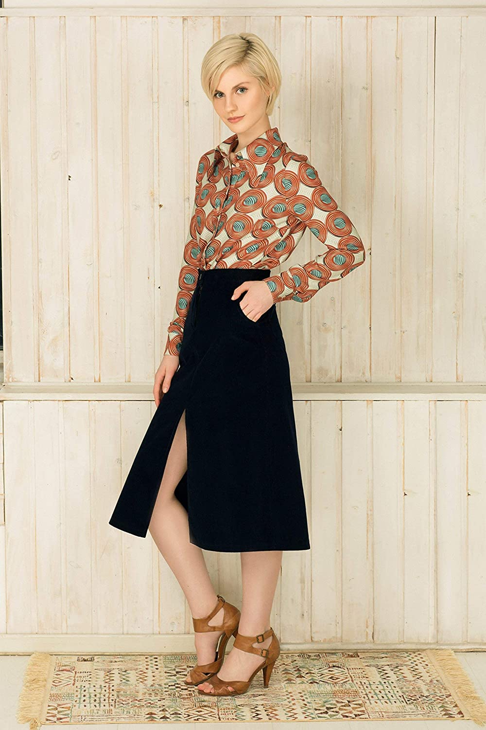 692b4a4a67 Made from one of our favorite fabrics of the season, this 70s style dark  blue midi skirt sits ...
