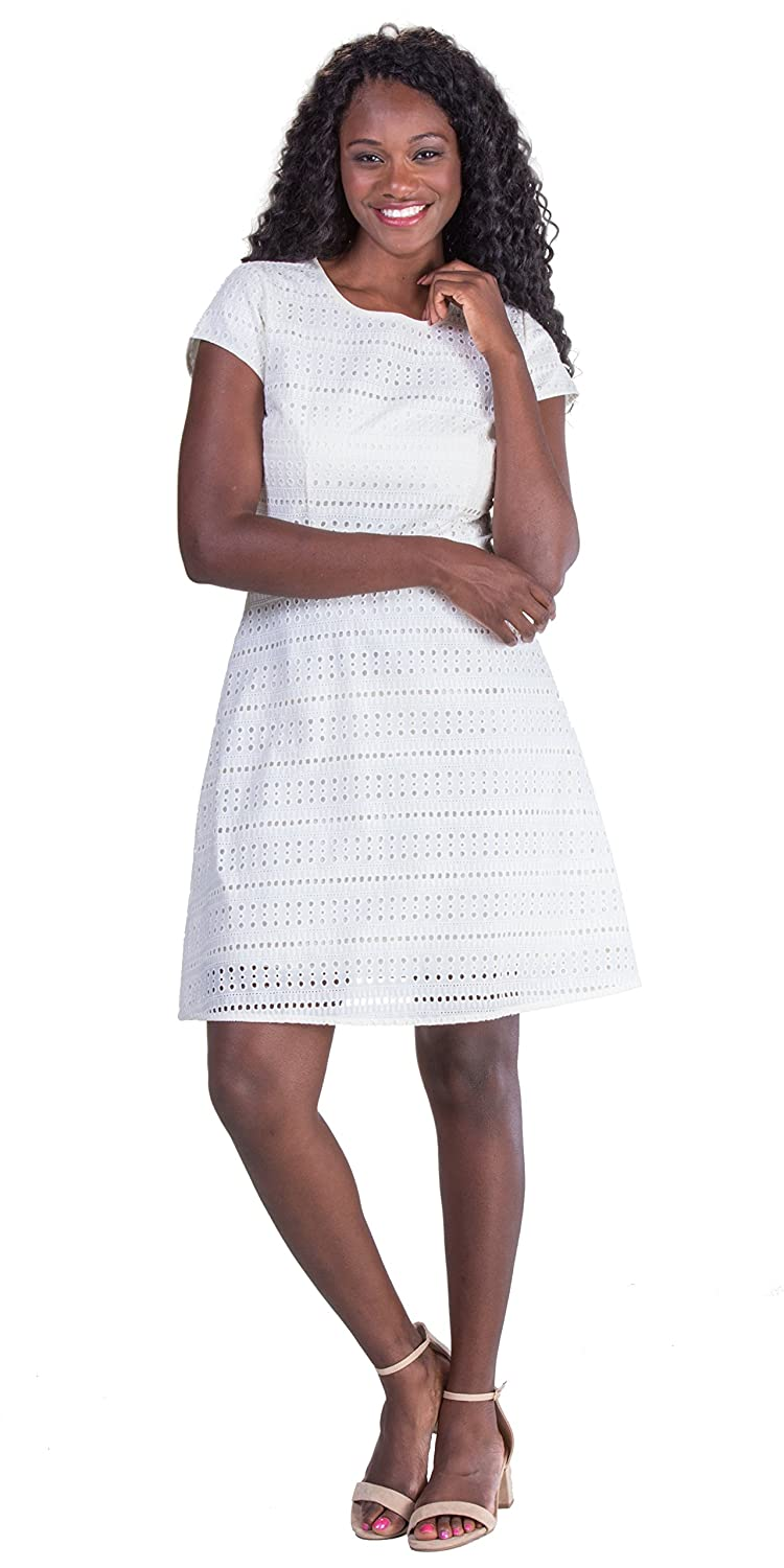 bd27809a5 Made of eyelet woven cotton. Fully lined dress has a scoop neckline, cap  sleeves and a back zipper closure. Short dress is approximately 36\'\' long  (our ...
