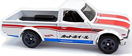 Amazon Com Hot Wheels Rad Trucks Datsun 620 4 8 White Toys Games