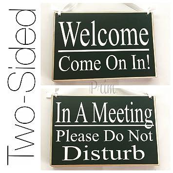 in a meeting door sign