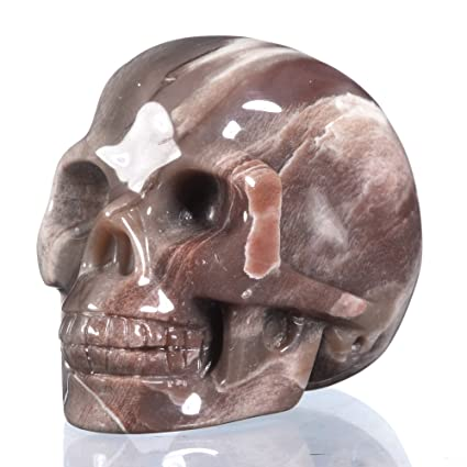 Small hand carved wooden skull bead