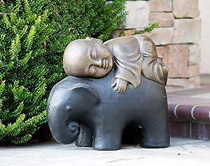 cute-shaolin-monk-on-elephant-statue