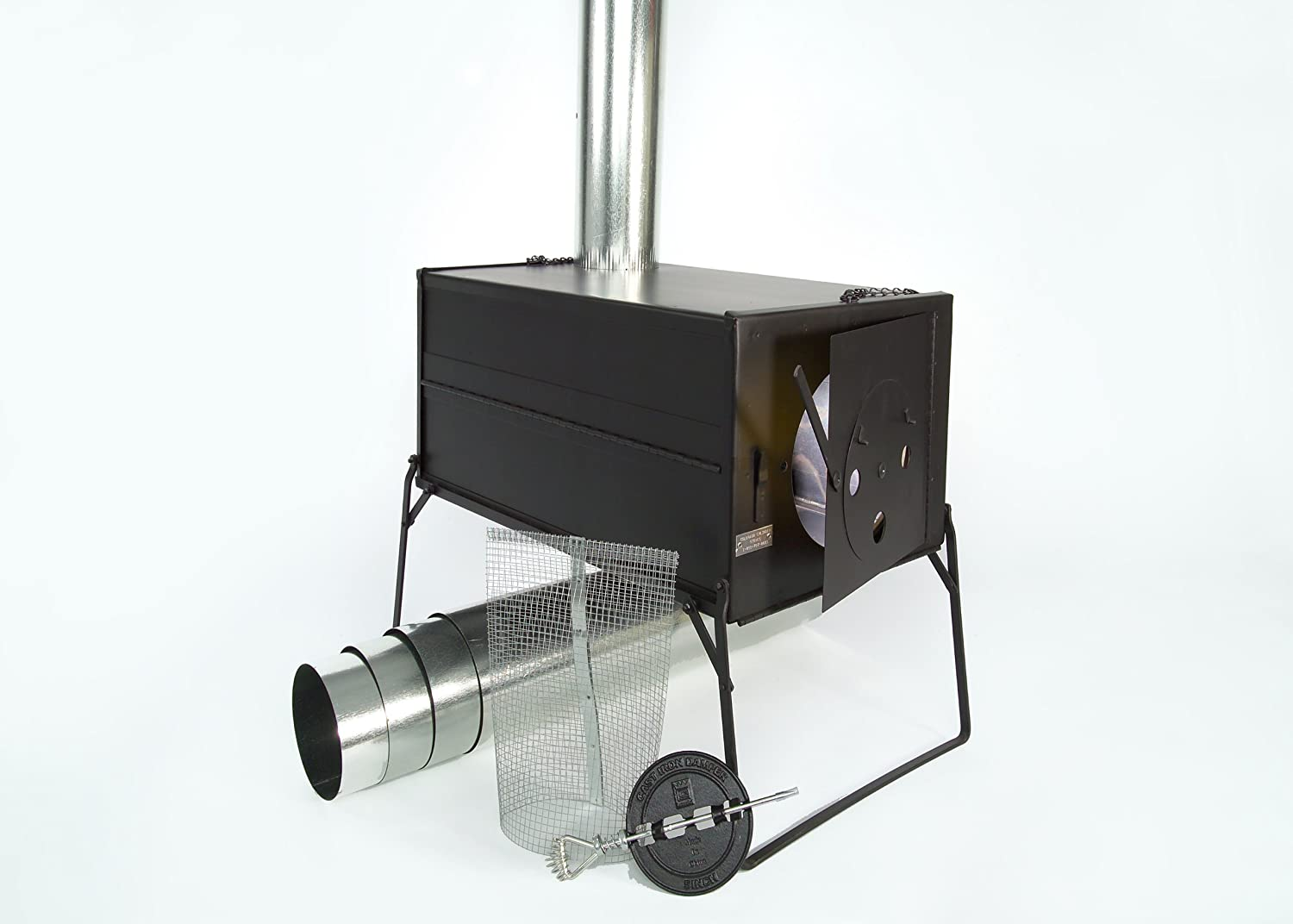 Photo of a tent stove with black square body, silver chimney pole attached to its one side