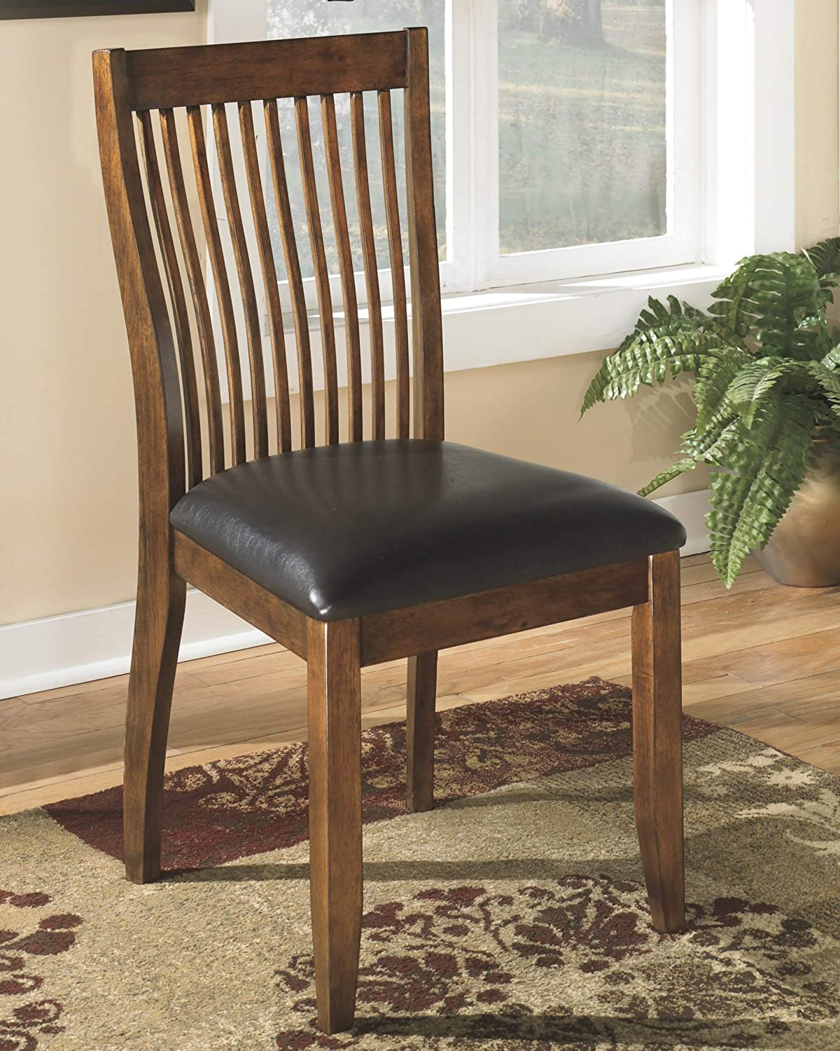 Ashley Furniture Signature Design – Stuman Dining Side Chair – Comb Back – Set of 2 – Brown Base and Black Upolstered Seat