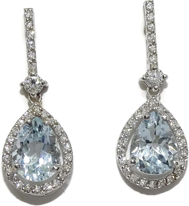 Impresionantes pendientes con 0.40cts de diamantes talla brillante y 2 aguas marinas finas talla pera de 8x6mm de 1.56cts montadas en oro blanco de 18kts con cierre presión