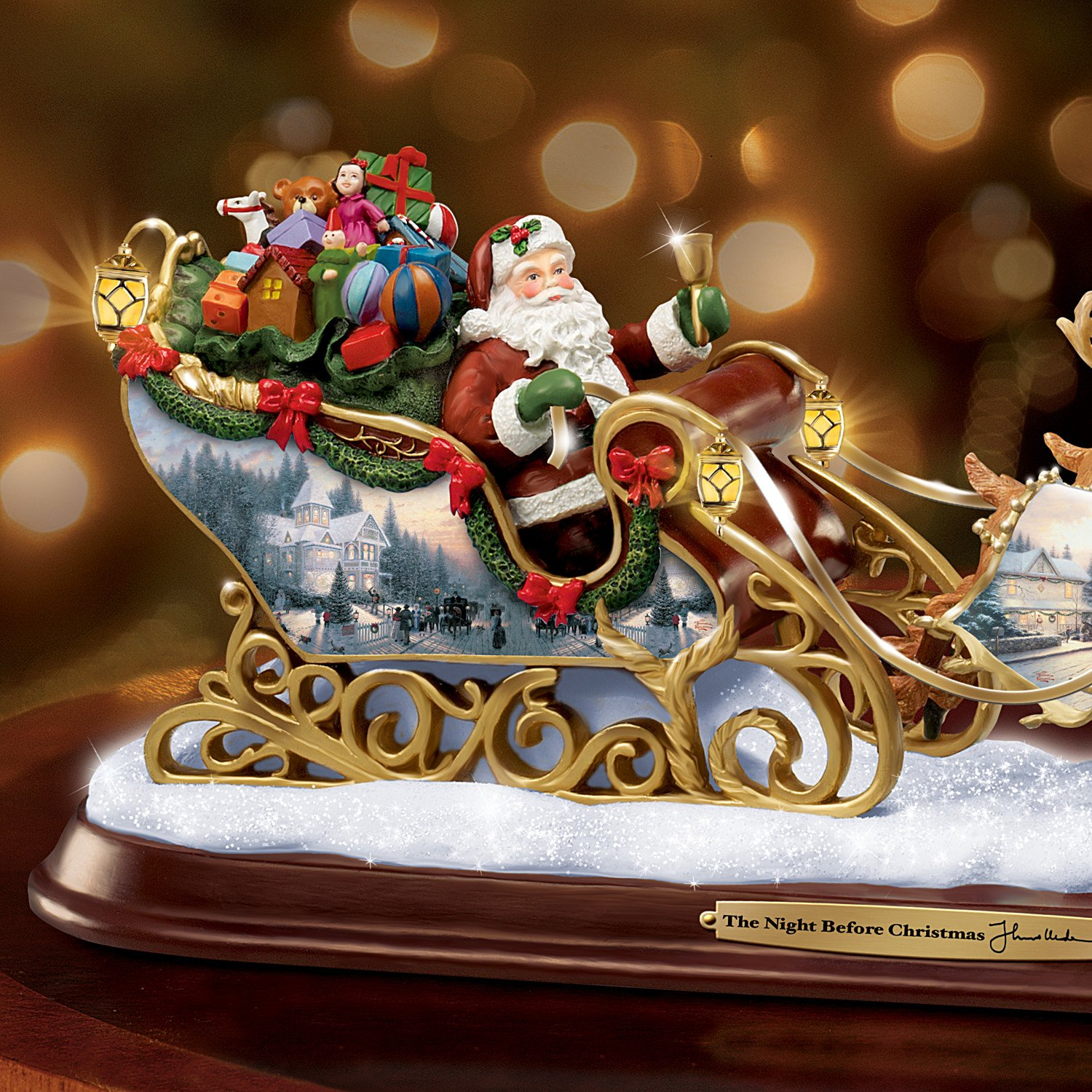 amazoncom thomas kinkade santas sleigh illuminated figurine the night before christmas by the bradford exchange home kitchen - Night Before Christmas Decorations