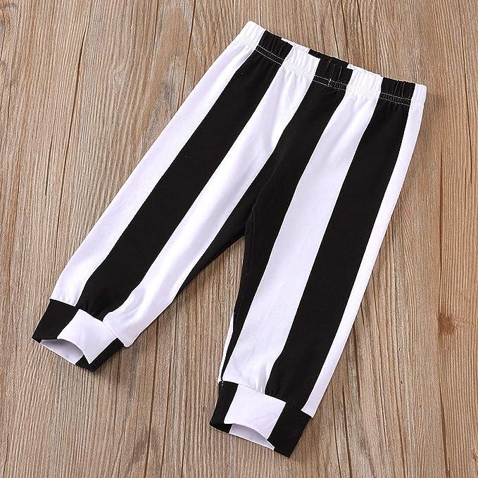Juego de 2 piezas de camiseta de manga larga con estampado de calabaza pantal/ón de rayas negro y blanco Carolilly