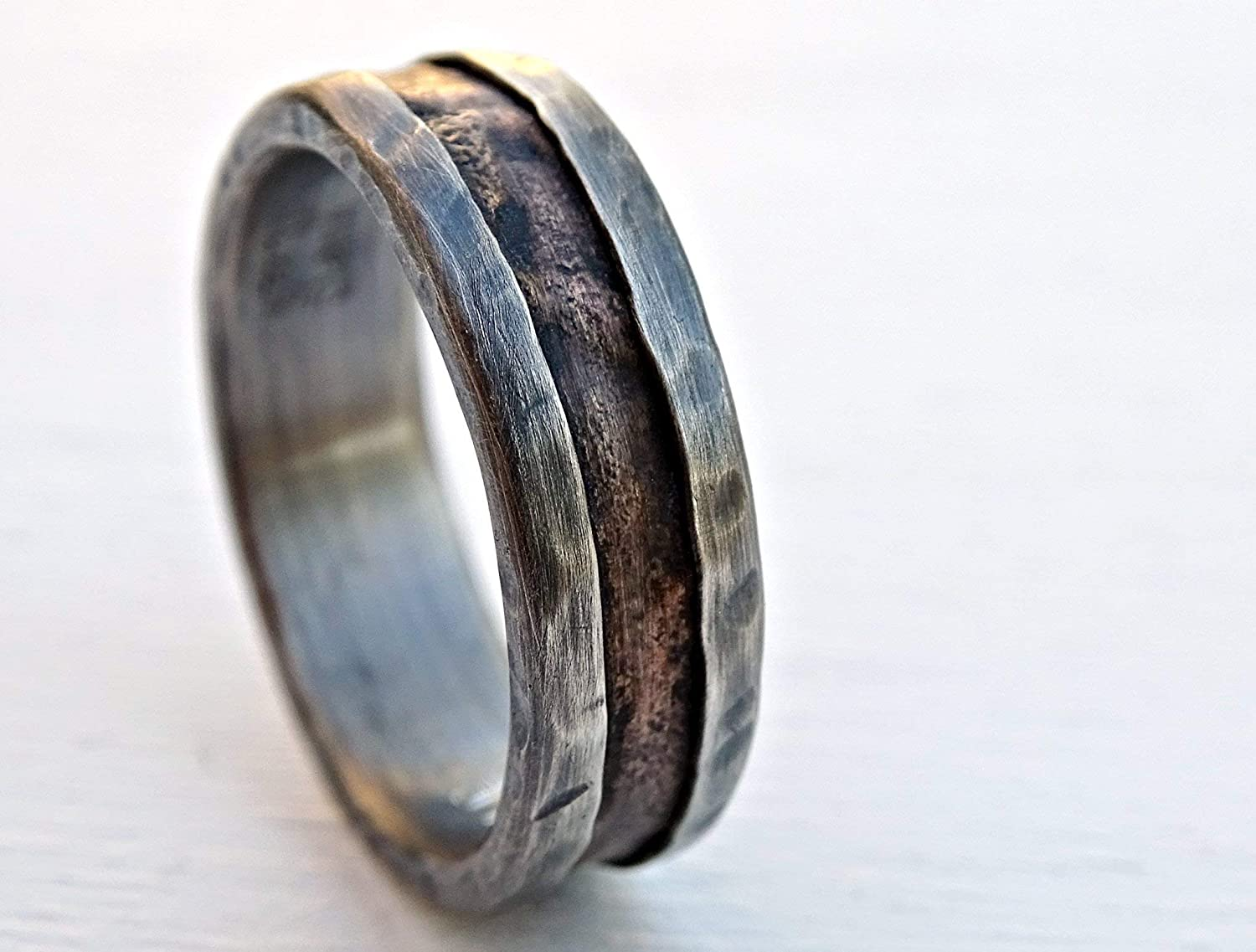 It is a photo of Amazon.com: Cool Mens Ring Bronze, Unique Wedding Band Bronze