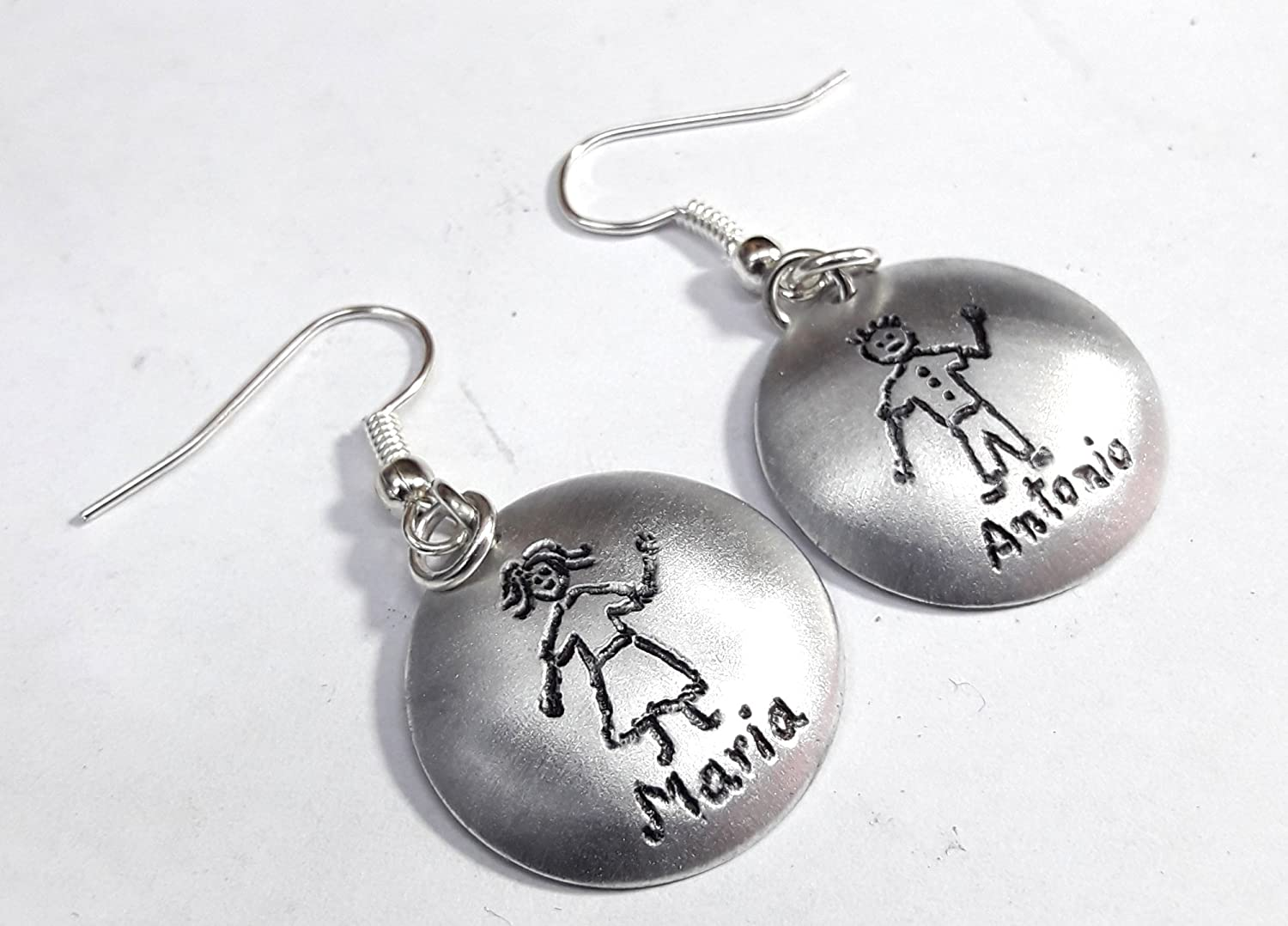 Aluminum earrings with engraving of human, and personalized names.