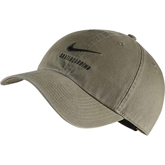 buy popular b59b0 0bb2a Amazon.com  Nike H86 SB Skateboarding Adjustable Hat Black White  828635-010  Clothing