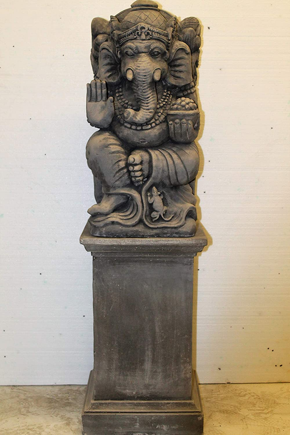 Ornate stone large ganesh on classic plinth garden ornament