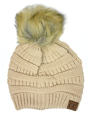 aeff0dc10be Plum Feathers Soft Stretch Cable Knit Ribbed Faux Fur Pom Pom Beanie Hat -  -  Amazon.co.uk  Clothing