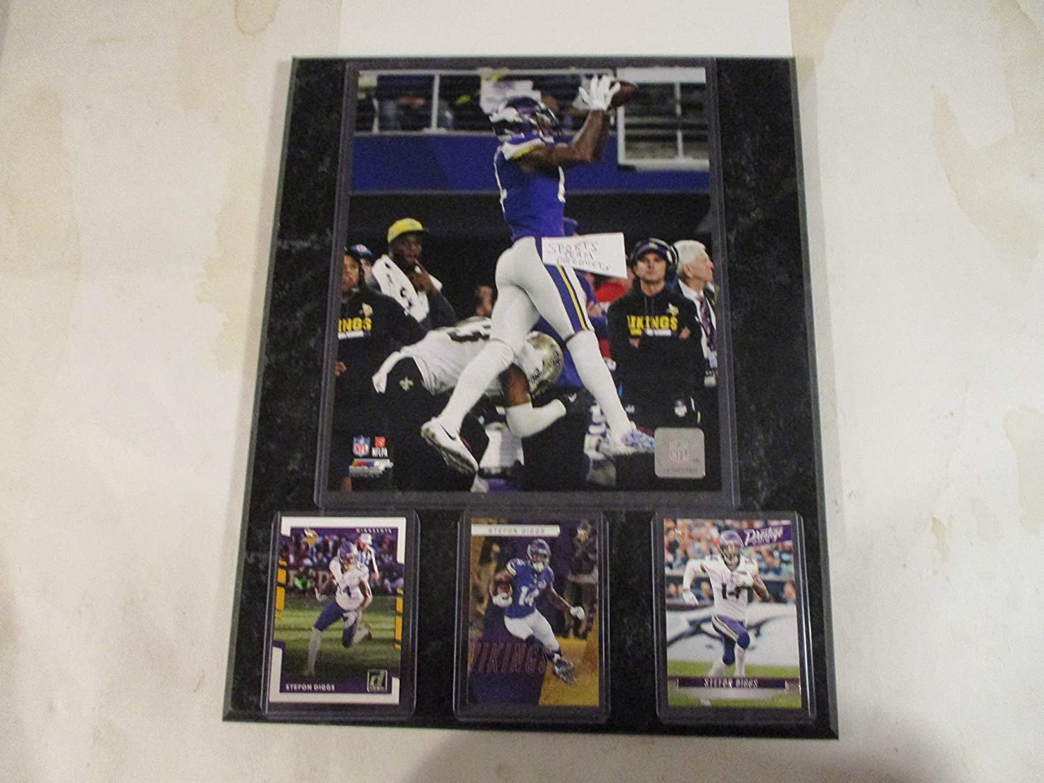 STEFON DIGGS MINNESOTA VIKINGS MIRACLE CATCH PHOTO PLUS 3 CARDS MOUNTED ON A 12' X 15' BLACK MARBLE PLAQUE