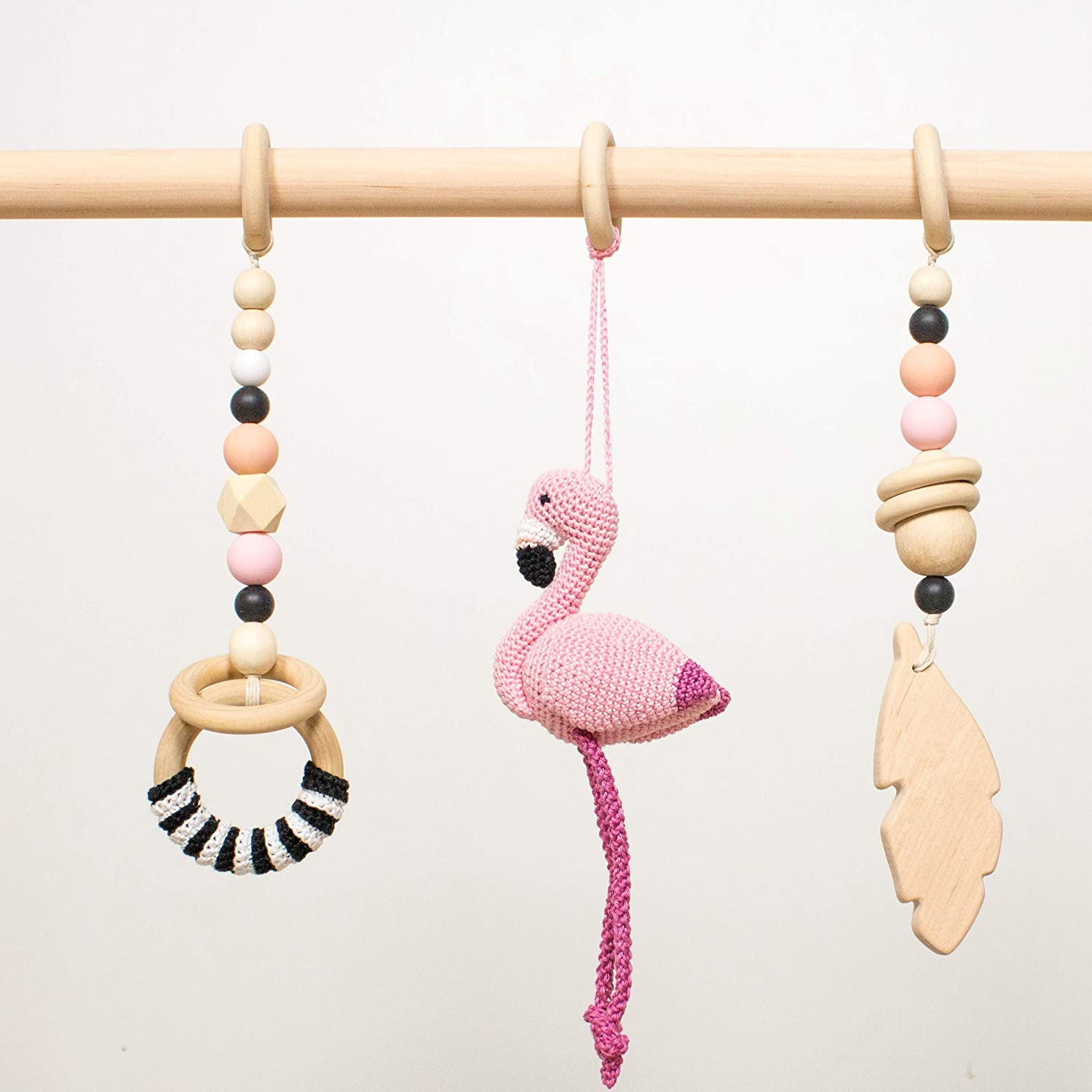 Black and pink baby gym mobiles by LanaCrocheting. Set of 3: Flamingo, feather, ring. Wooden play gym hangers. Crochet rattle. Baby shower gift. Sensory development.
