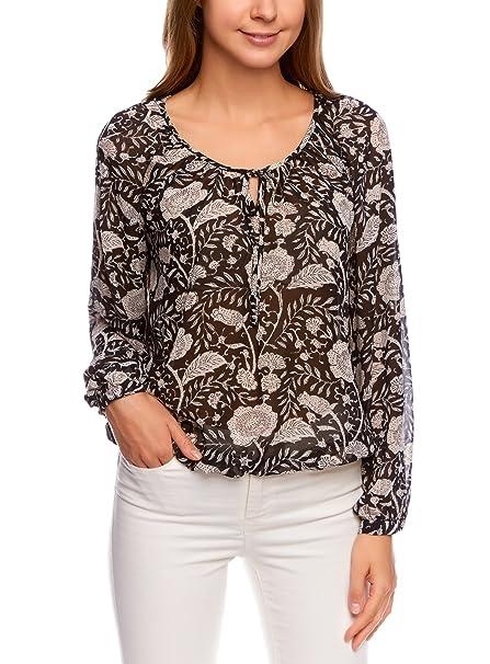 Blusa transparente muy suave con estampado florarl y lazos.