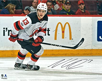 Nico Hischier New Jersey Devils Autographed 16 quot  x 20 quot  White Jersey  Skating Photograph - 2a50d4023