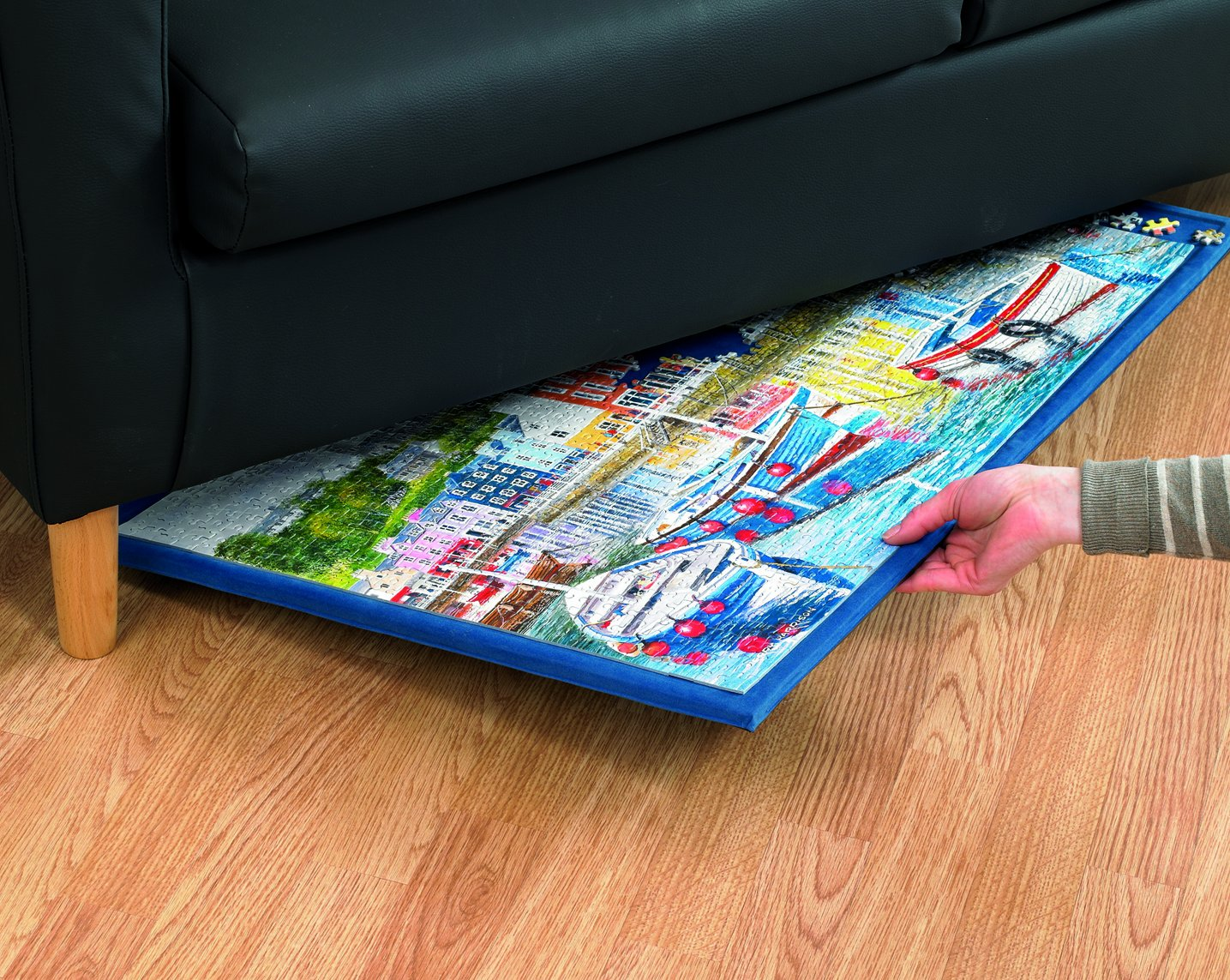 The Puzzle Board by Gibsons fits nicely under the sofa or bed