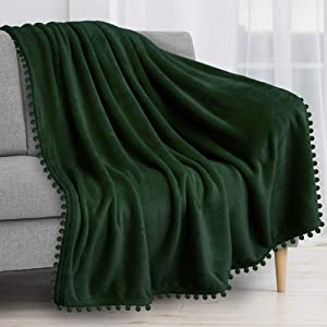 PAVILIA Fleece Throw Blanket with Pom Pom Fringe | Emerald Green Flannel Throw | Super Soft Lightweight Microfiber Polyester | Plush, Fuzzy, Cozy, Dark Green | 50 x 60 Inches