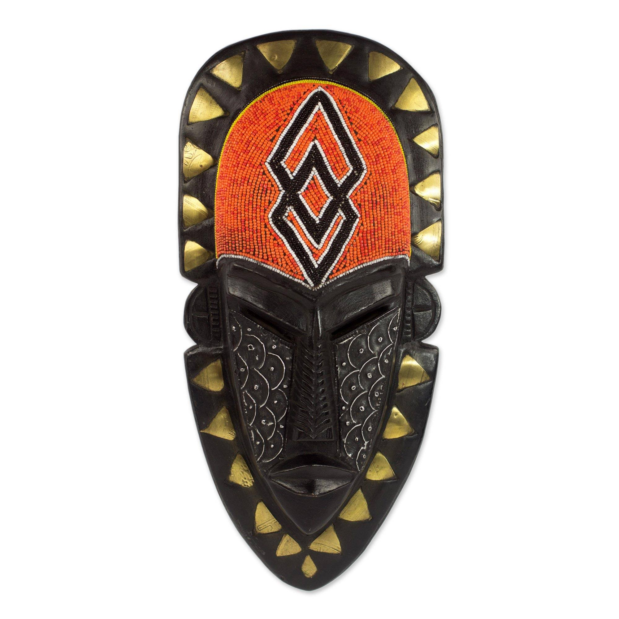 NOVICA Black and Orange African Sese Wood Wall Mask with Brass and Aluminum Accents, Fearless Warrior'