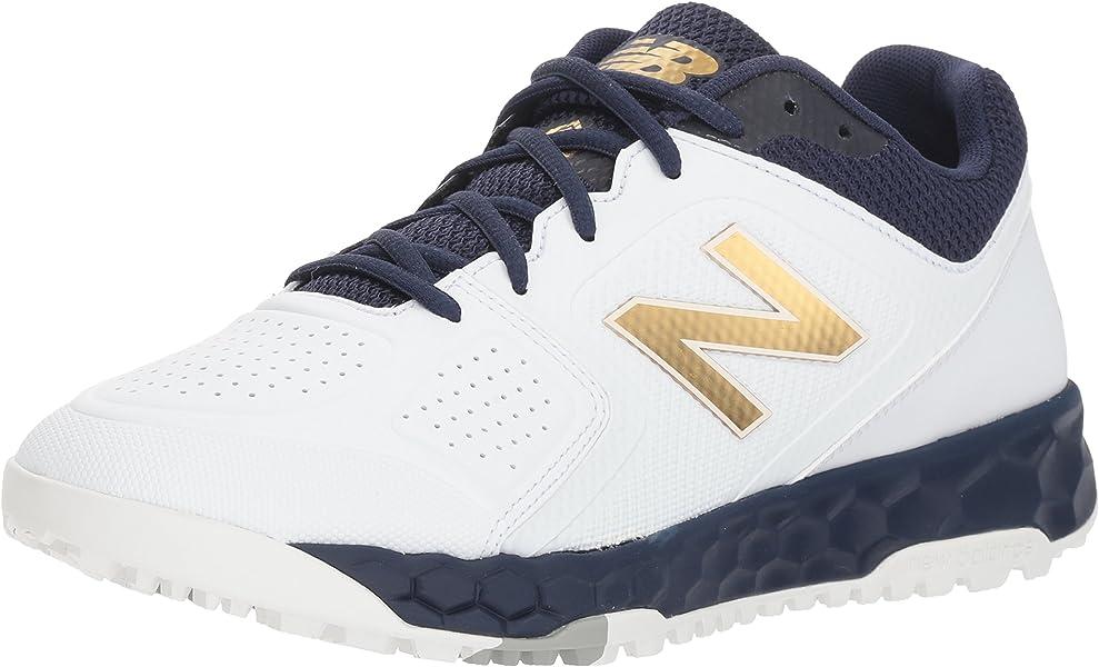 2ab1b8c1c929 Amazon.com | New Balance Women's Velo V1 Turf Softball Shoe Navy ...