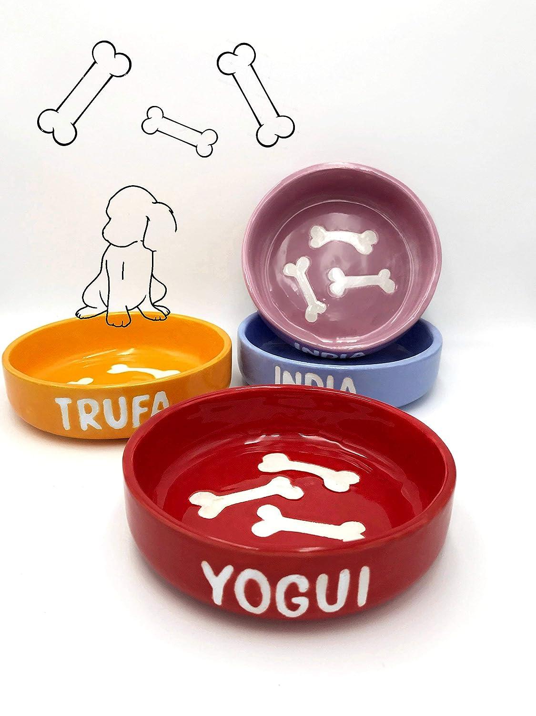 Comedero personalizado para perros en cerámica, con dibujo de huesos.