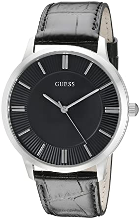 98de51fca1439 GUESS Men s U0664G1 Dressy Silver-Tone Watch with Plain Black Dial and  Genuine Leather Strap