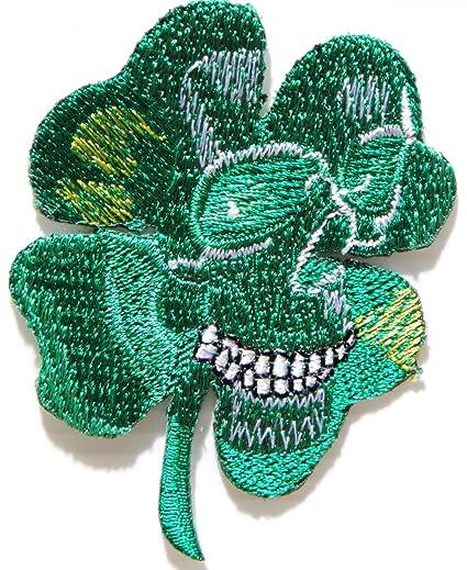 Parche o insignia con forma de trébol de cuatro hojas y diseño