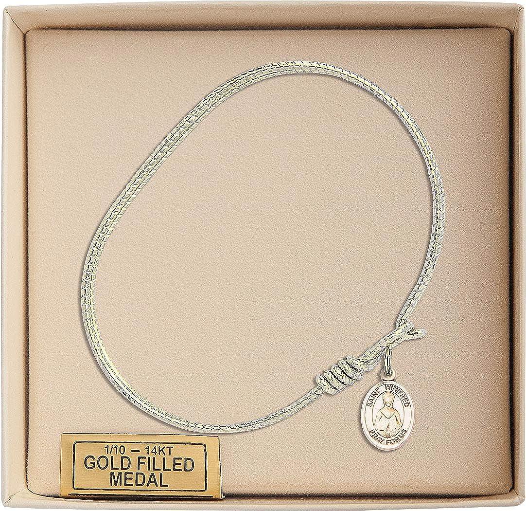 St Winifred Of Wales Charm On A 6 1//4 Inch Oval Eye Hook Bangle Bracelet
