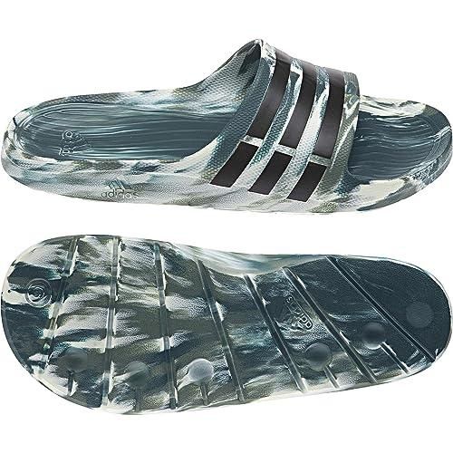 timeless design 9f48e 7e613 Adidas Duramo Slide, Chanclas Unisex Adulto Amazon.es Zapatos y  complementos