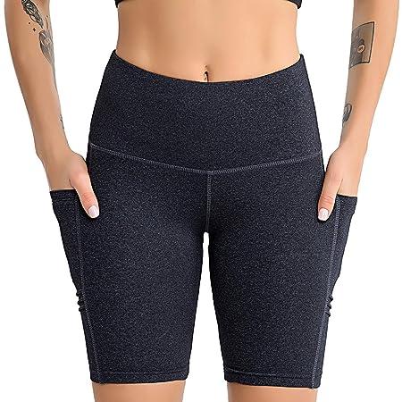 Los pantalones de yoga de las mujeres con teléfono de ...