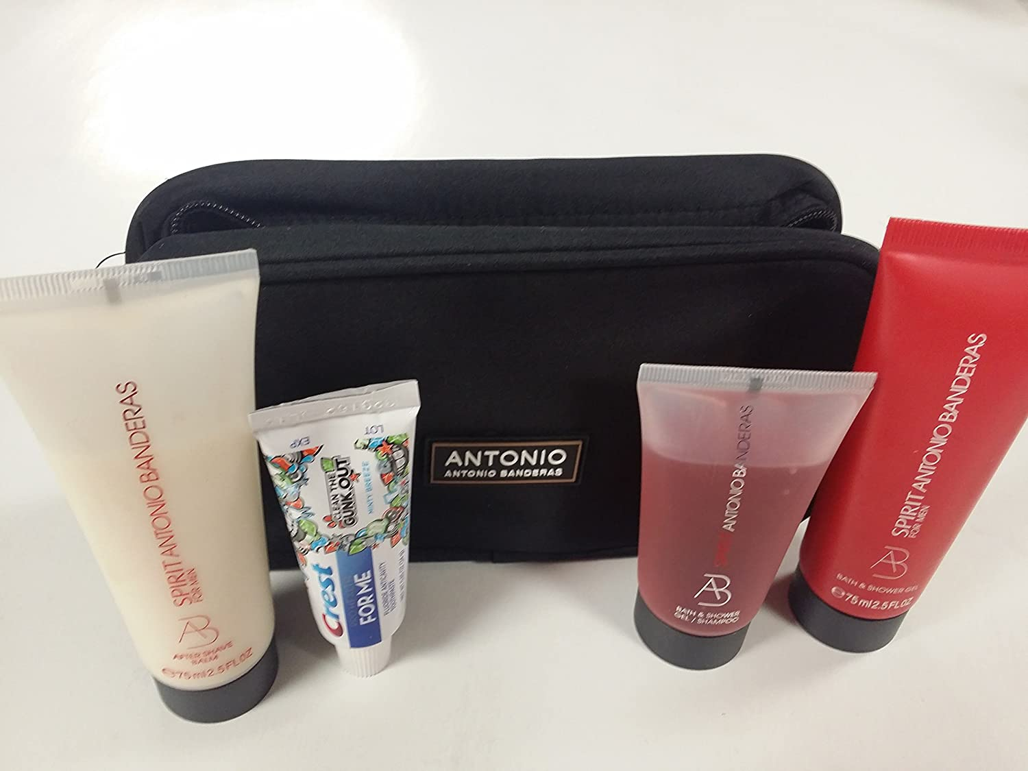 Antonio Banderas Travel Kit with Black Bag, Spirit After Shave Balm, Bath and Shower Gel/Shampoo and Crest Toothpaste