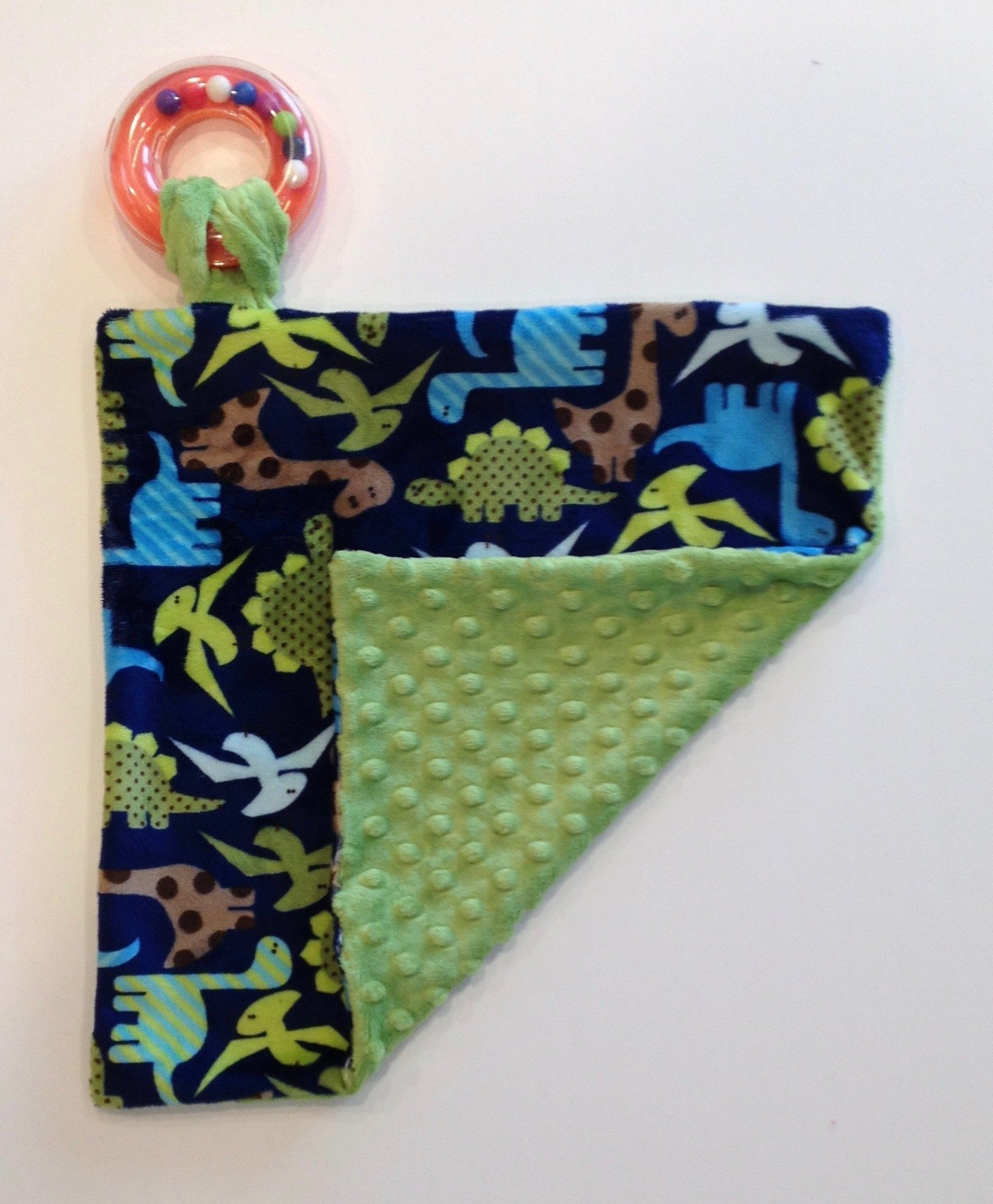 Baby Pacifier/Toy Blanket. Dinosaur Cuddle. You choose the Dimple Dot back. Back is pictured in Jade Dimple Dot.