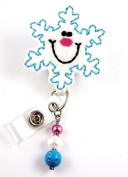 amazon com smiling christmas snowflake nurse badge reel