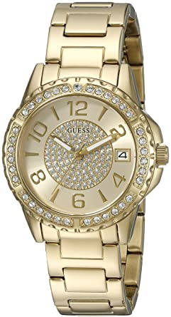 GUESS Womens Crystal Accented Bracelet Watch with Date Function. Color: Gold-Tone (