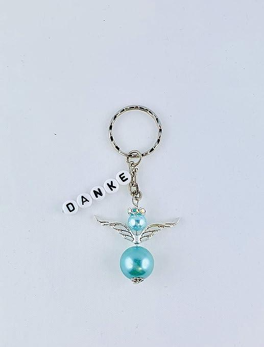 Buntermix - Llavero con diseño de ángel de la Guarda con ...
