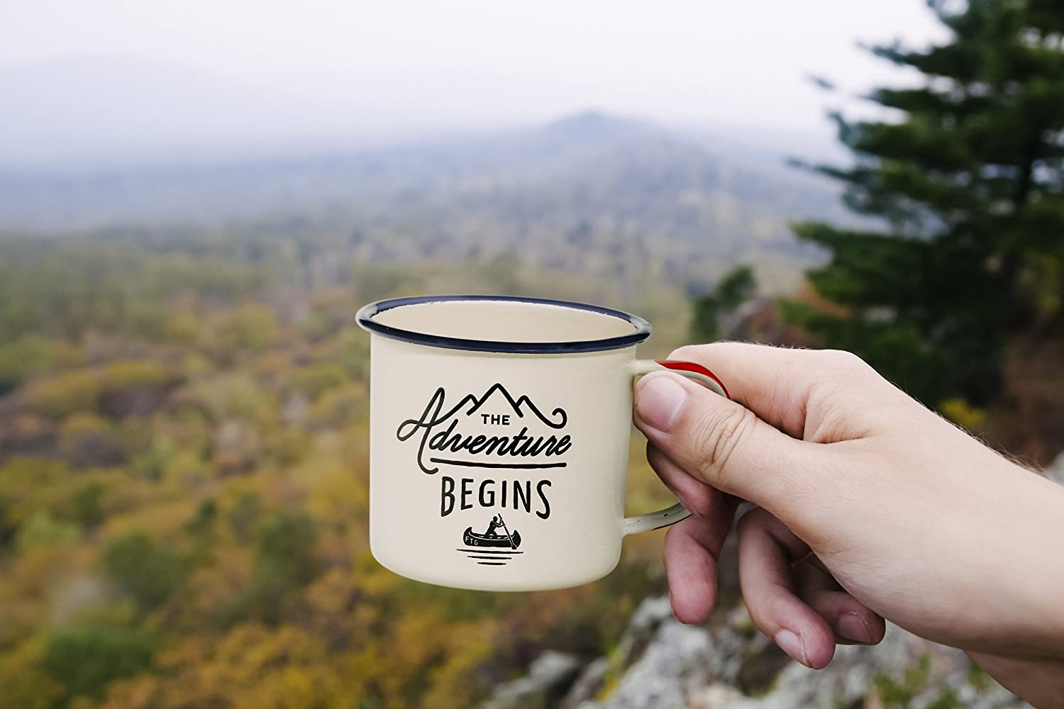 The Adventure Begins Enamel Camping Coffee Mug is awesome gear to use with this campfire French toast recipe which is a CampingForFoodies baked Dutch oven French toast and is filled with spices including cinnamon, nutmeg and cloves making this camping French toast sweet with a powdered sugar glaze.