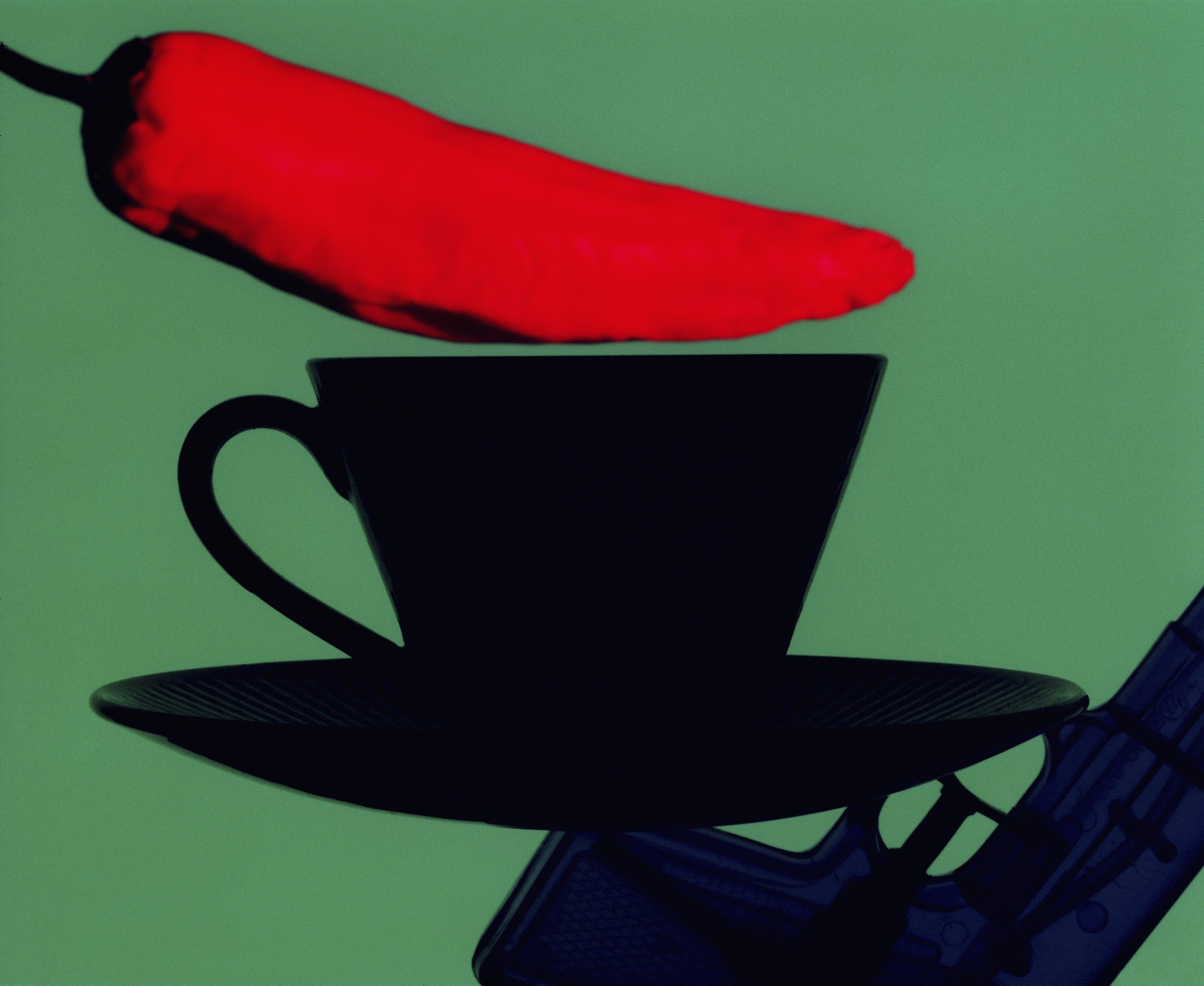Reprint of Close-up of a coffee cup with a red chili pepper