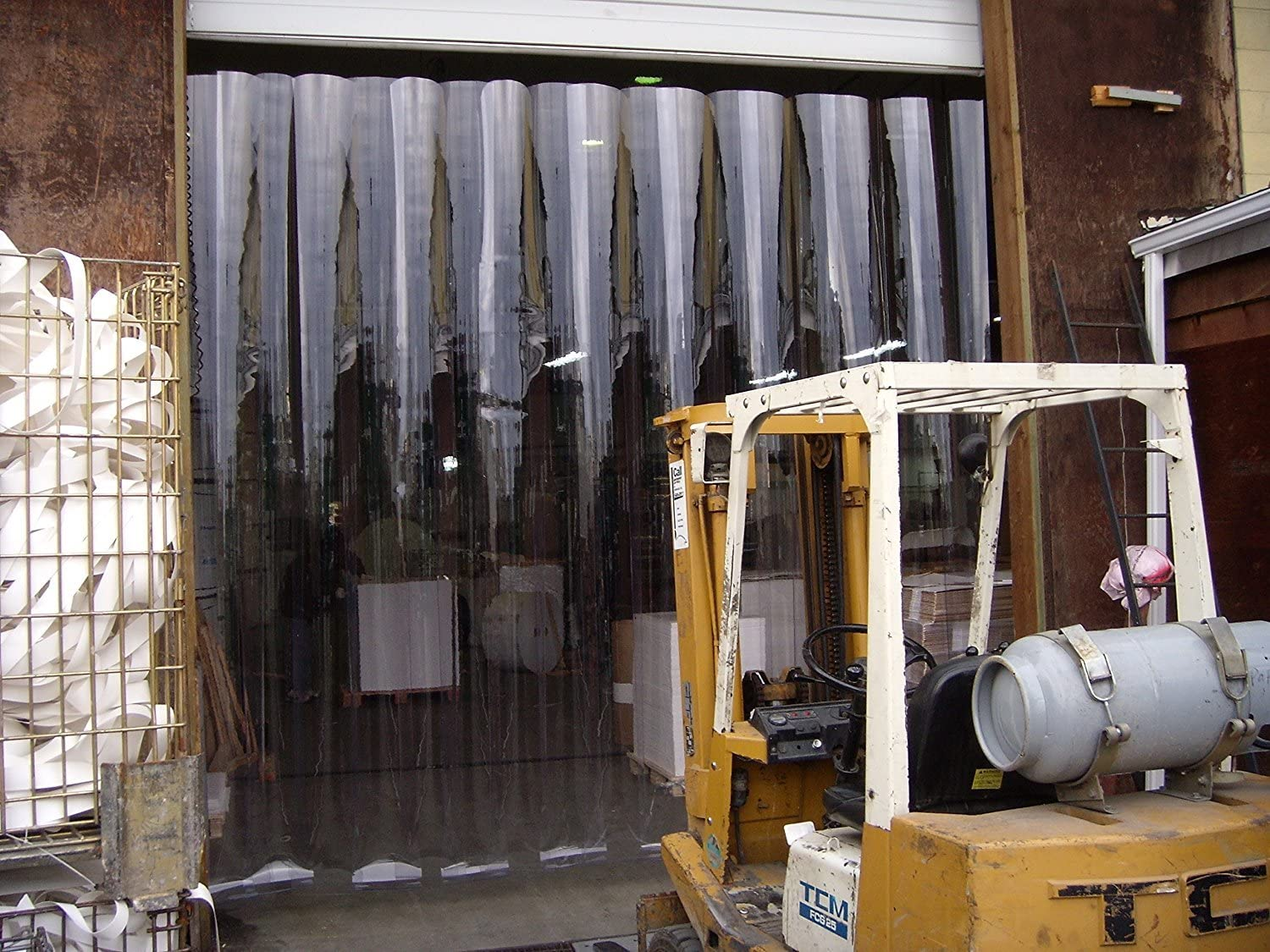 48 in. strips with 50/% overlap Hardware included Strip-Curtains.com: Strip Door Curtain common door kit width X 96 in. 8 ft 4 ft height Standard smooth 8 in