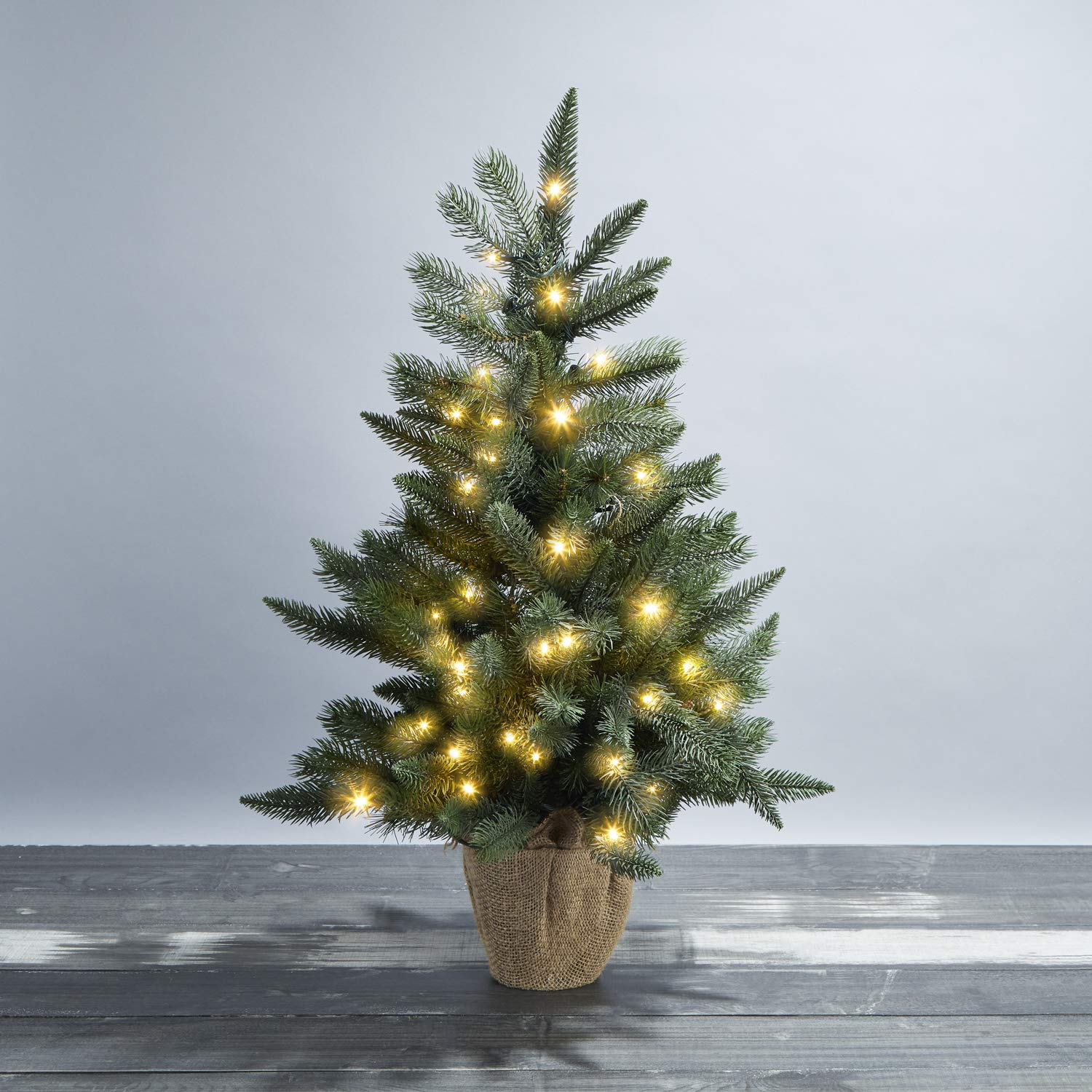 LampLust 30'' Pre-Lit Mini Christmas Tree - Pine Tree with 70 Warm White LED Lights, Decorative Burlap Base, Convertible Power Options, Both Battery Box and Plug Included