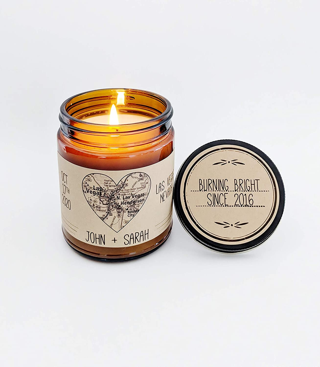This is an image of a personalized handmade scented candle in a jar for couples.